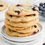 blueberry cookies stacked on top of each other on a plate