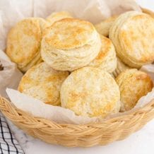 close up shot of buttermilk biscuits in a bread basket