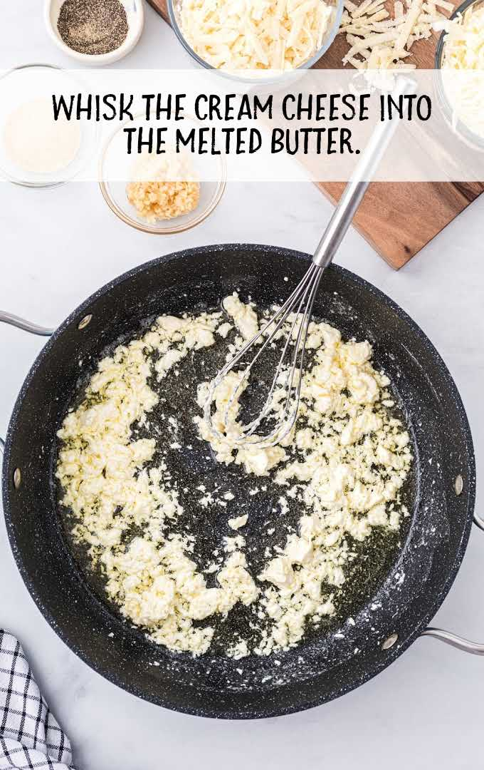 chicken alfredo bake process shot of ingredients being whisked together in a skillet