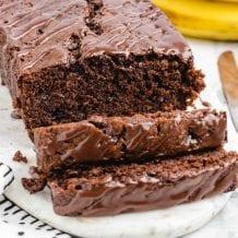 chocolate banana bread with chocolate glaze sliced on a tray