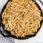 close up overhead shot of creamy chicken pasta in a pan