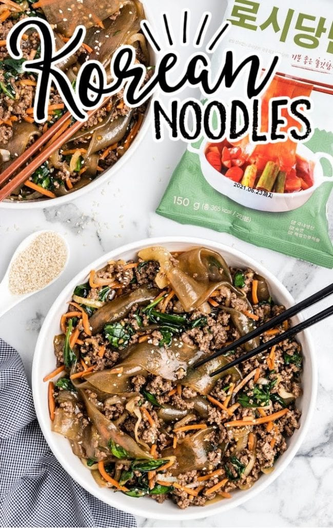 A bowl filled with different types of food, with Noodle and Sauce