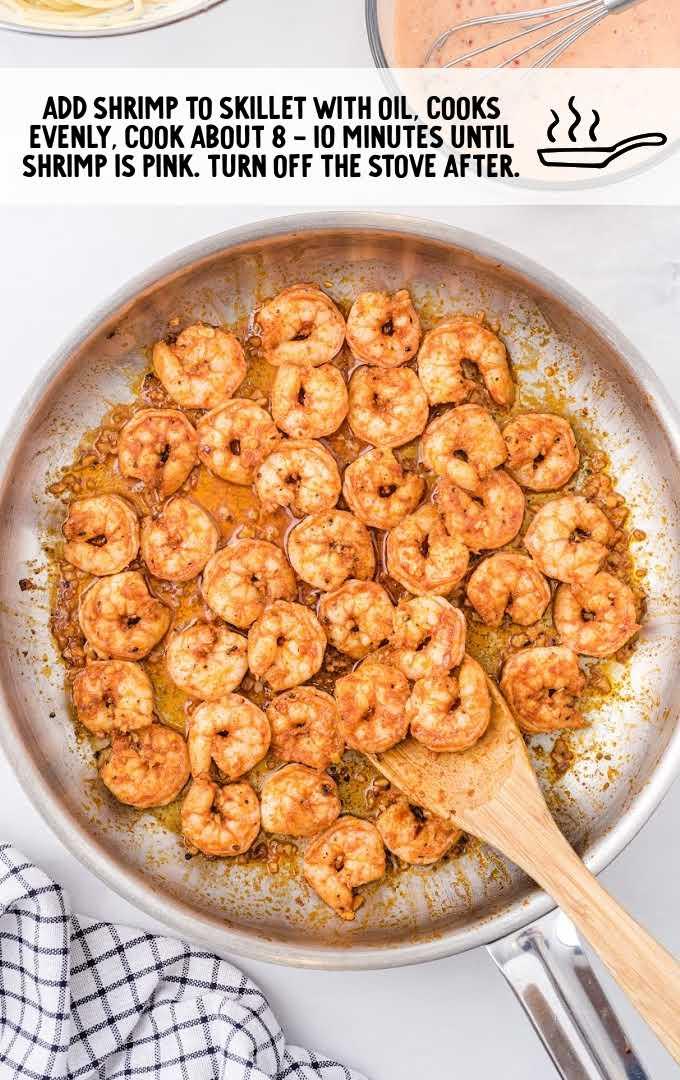bang bang shrimp pasta process shot of shrimp being cooked on a skillet