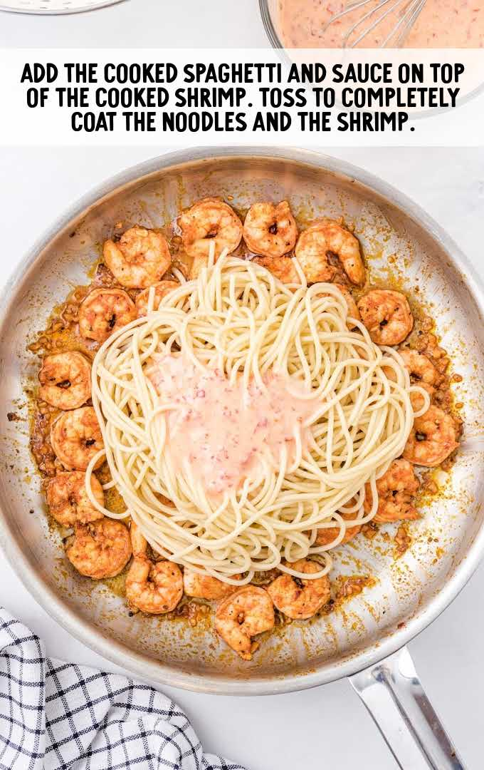 bang bang shrimp pasta process shot of spaghetti and sauce being placed on shrimp in a skillet