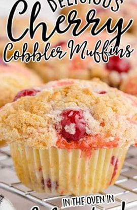 close up shot of cherry cobbler muffins on a cooling rack