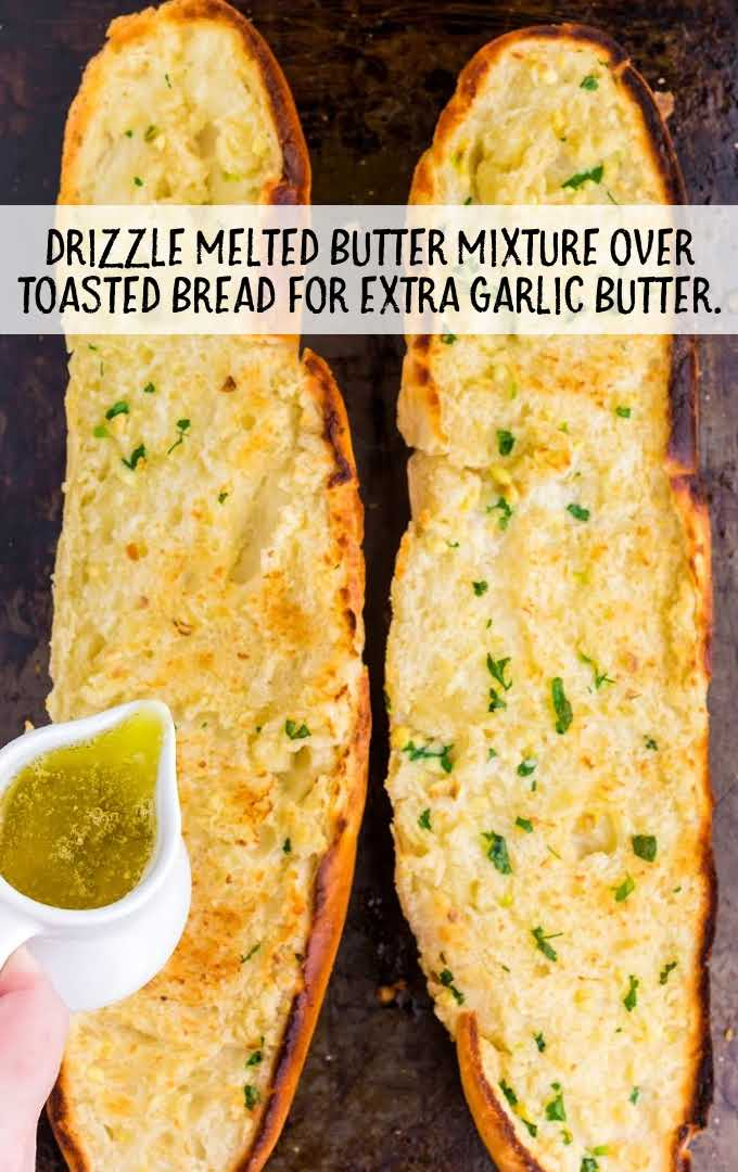 garlic bread process shot of 2 loaves of bread with melted butter being poured on top