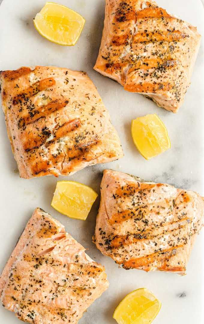 close up overhead shot of slices of grilled salmon with slices of lemon