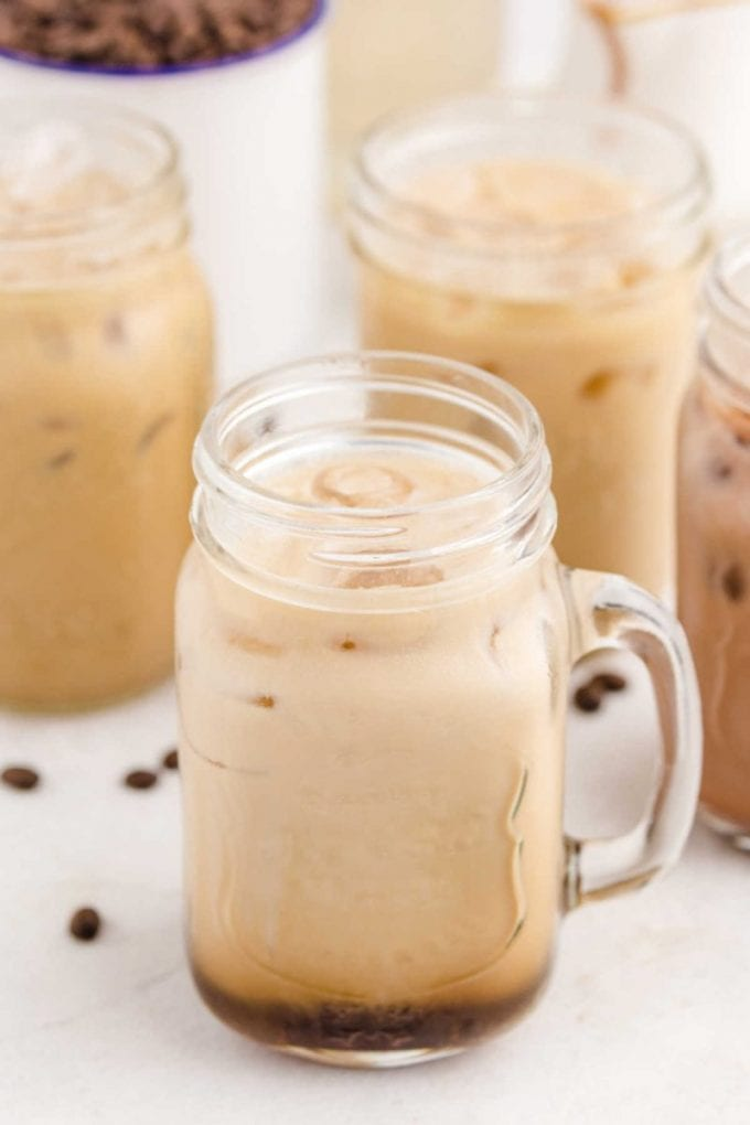 glasses of different flavors of Iced Caramel Macchiato