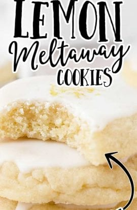 close up shot of lemon meltaway cookies stacked on top of each other with a bite taken out of one