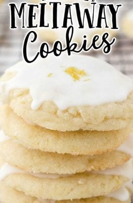 close up shot of lemon meltaway cookies stacked on top of each other on a rack