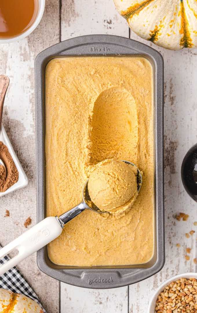 overhead shot of pumpkin ice cream being scooped with a ice cream scooper