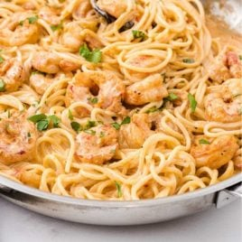 close up shot of bang bang shrimp pasta in a skillet