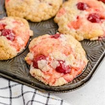 close up shot of cherry cobbler muffins in a muffin pan