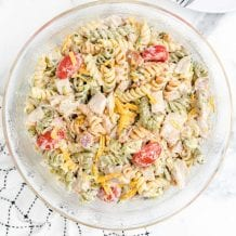 overhead close up shot of chicken bacon ranch pasta salad with ranch dressing in a bowl