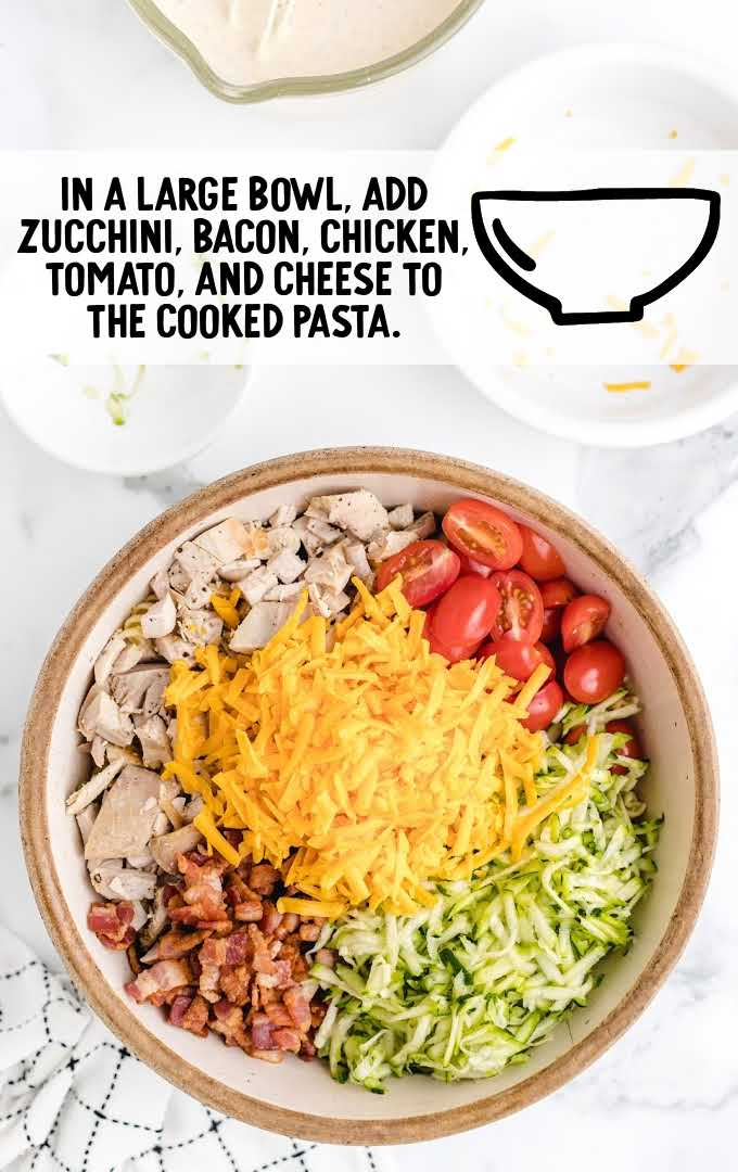 chicken bacon ranch pasta salad process shot of ingredients in a bowl