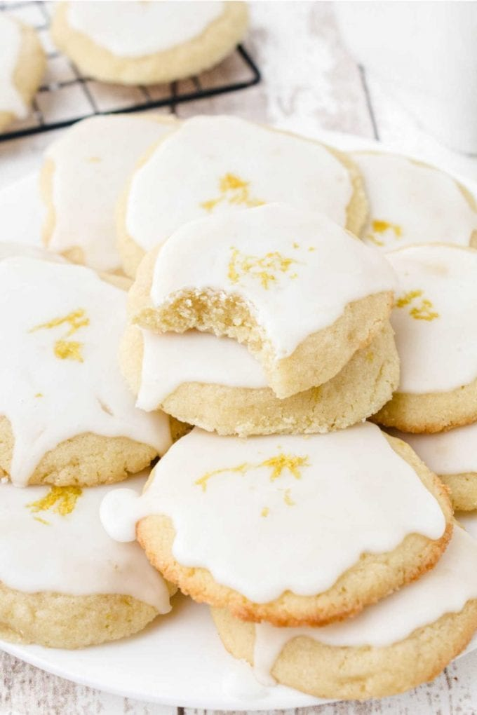 close up shot of lemon meltaway cookies piled on top of each other on a plate