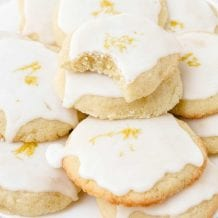 close up shot of lemon meltaway cookies piled on top of each other