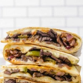 steak quesadilla recipe stacked on top of each other on a plate