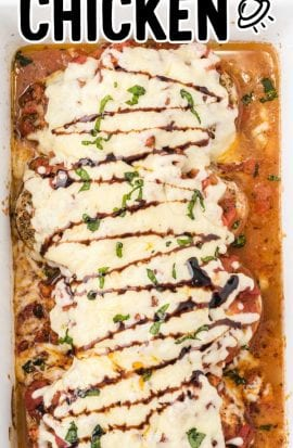 overhead shot of baked bruschetta chicken topped with mozzarella cheese then drizzled with balsamic glaze and basil in a baking dish