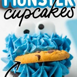 close up shot of Cookie Monster Cupcakes with candy eyes and a cookie
