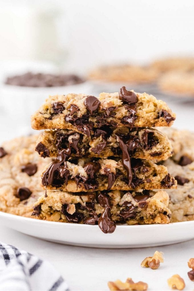 close up shot of DoubleTree Cookies stacked on top of each other showings it's melted chocolate on a plate