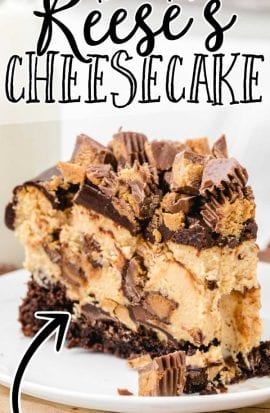 close up shot of a slice of Reese's cheesecake topped with chocolate ganache and pieces of Reese's cups on a plate