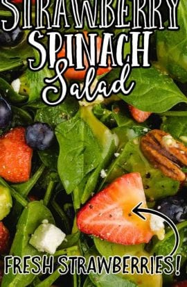 close up overhead shot of strawberry spinach salad garnished with feta cheese