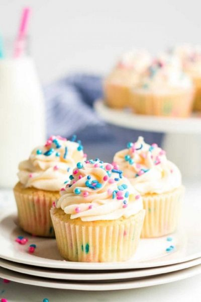 Gender Reveal Cupcakes with sprinkles on a plate