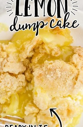 close up overhead shot of a serving of lemon dump cake on a plate with a fork