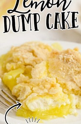 close up shot of a serving of lemon dump cake on a plate with a fork