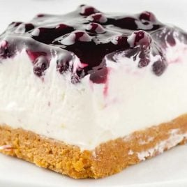 close up shot of a slice of No Bake Blueberry Cheesecake on a plate