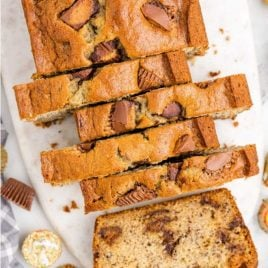 close up overhead shot of a loaf of Reese's peanut butter banana bread sliced