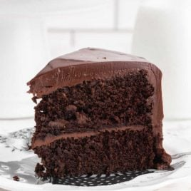 close up shot of a slice of black magic cake on a plate