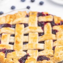 close up shot of blueberry pie in a clear baking pan