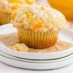 close up shot of peach cobbler muffins on a plate
