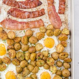 close up shot of sheet pan breakfast garnished with parsley in a sheet pan