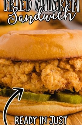 close up shot of fried chicken sandwich on a wooden board