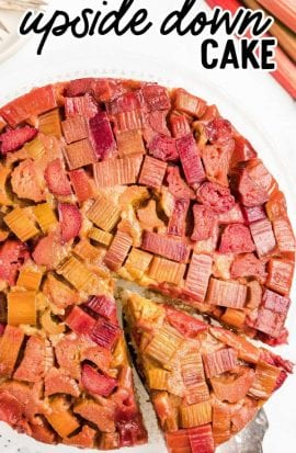 close up overhead shot of Rhubarb Upside Down Cake with a slice being taken out of it