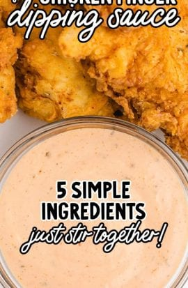 close up overshot of chicken finger dipping sauce in a bowl with chicken tenders on the side