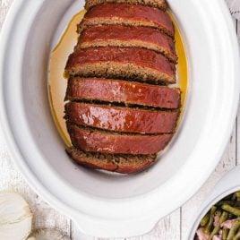 close up overhead shot of crockpot meatloaf sliced in a crockpot