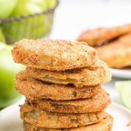 close up shot of fried green tomatoes stacked on top of each other on a plate
