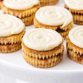 close up shot of mini cinnamon roll cheesecakes
