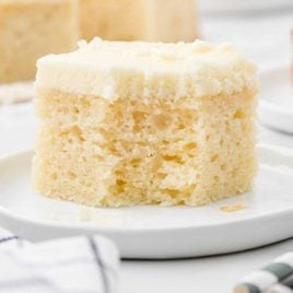 close up shot of a slice of vanilla snack cake recipe on a plate
