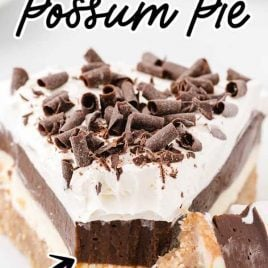 close up shot of a slice of Arkansas Possum Pie topped with chocolate shavings with a piece being taken out of pie with a fork on a plate