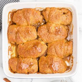 close up overhead shot of easy apple dumplings in a baking dish