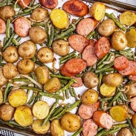 close up overhead shot of Sausage Green Bean Potato Casserole on a sheet pan