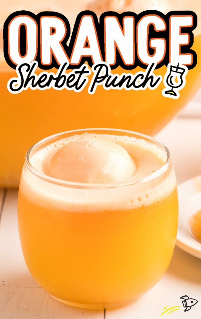 a glass of orange sherbet with a scoop of ice cream on top