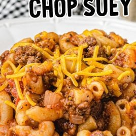 close up overhead shot of American Chop Suey topped with cheddar cheese on a plate