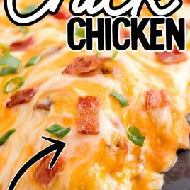 close up shot of Baked Crack Chicken garnished with bacon and green onions in a baking dish