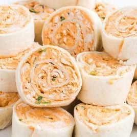 close up shot of Buffalo Chicken Pinwheels piled on top of each other